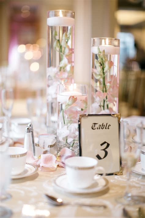 floating candle centerpieces  blush orchids  rose