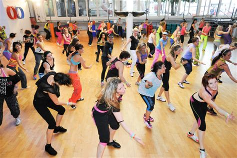download tutorial zumba dance people dancing during zumba training fitness at a gym