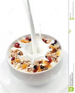 milk splashing into a bowl of fresh muesli stock photo image 44571517