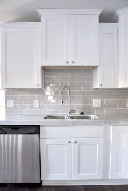 smoke glass subway tile white shaker cabinets shaker