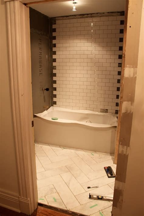 herringbone bathroom boys bathroom herringbone style floor subway tile shower