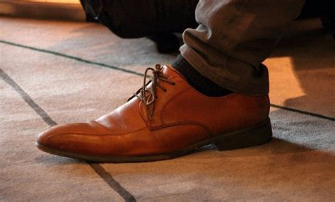 how to tie your shoes the right way one simple trick to tying dress shoe laces correctly