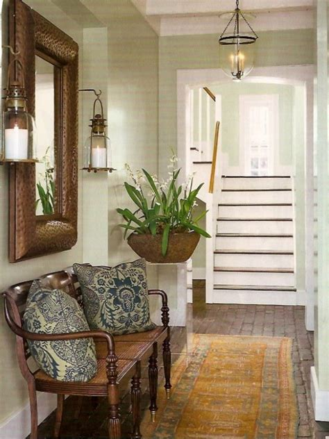 entryway inspiration entry bench mirror sconces fern blue white pillows