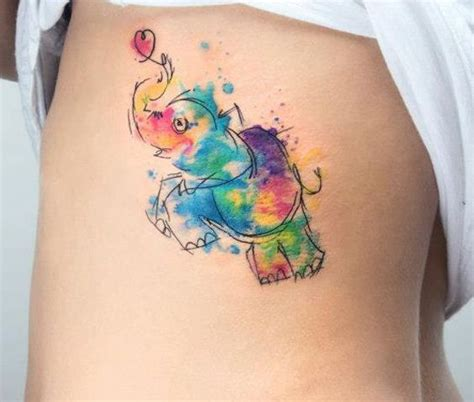 abstract watercolor elephant tattoo on ribs hair