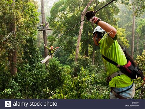 Kaos Souvenirs Thailand Jungle Tour jungle flight zip line and forest canopy tour chiang mai thailand stock photo royalty free