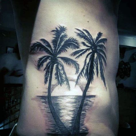 black sea tattoo palm trees with sunset reflecting sea on torso