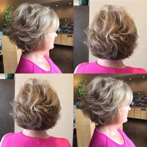 hairstylist giving a customer the 1970 s feathered look 60 best hairstyles and haircuts for women over 60 to suit