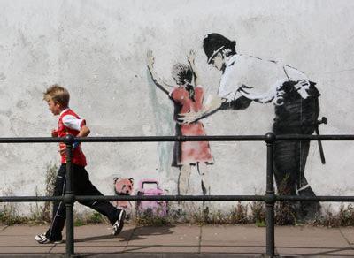 banksy police stop  search girl glastonbury
