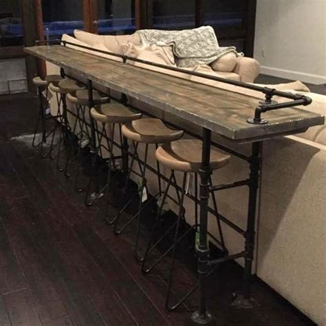 behind couch bar table pipe work and reclaimed timber work very well together for