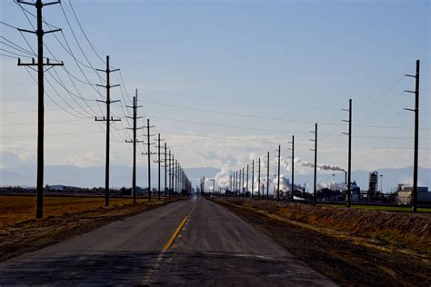 road utilities road surrounded by telephone poles free stock photo