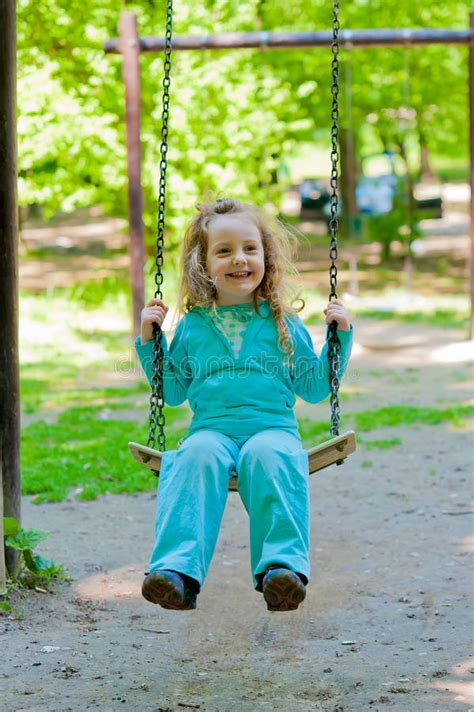 swing girls download little girl smiling playing on the swing stock image