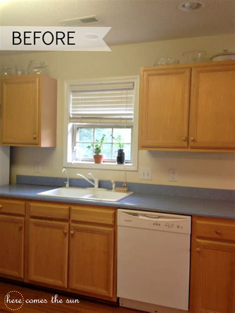 kitchen cabinet contact paper update cabinets with contact paper here comes the sun
