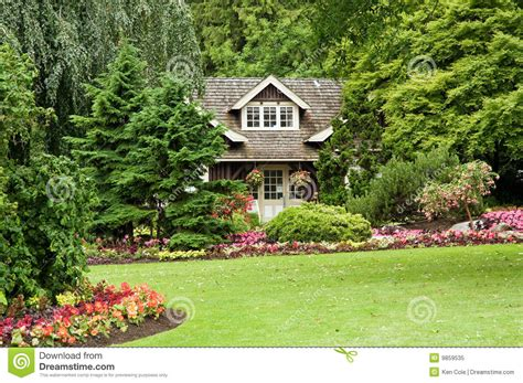 English Cottage Plans landscaped cottage in woods royalty free stock photo