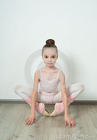 Toddler Floor Plan by A Little Adorable Young Ballerina Does Ballet Poses Stock