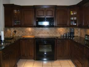 brown kitchen cabinets with countertop and lighter