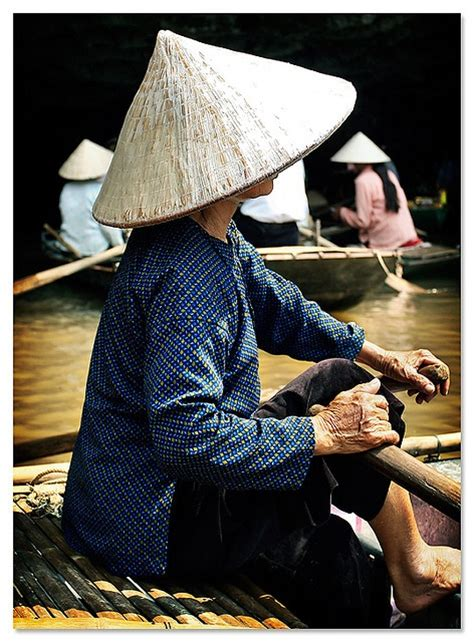 the boat girl by nguyen binh conical hats boating and rivers