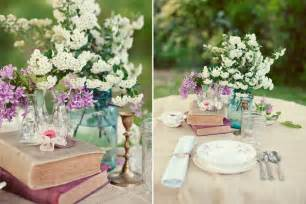 table wedding centerpieces wedding table setting ideas vintage books blue jar centerpieces white flowers the
