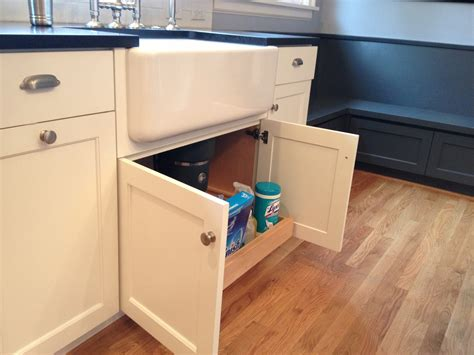 custom white cabinets with farmhouse sink pull out