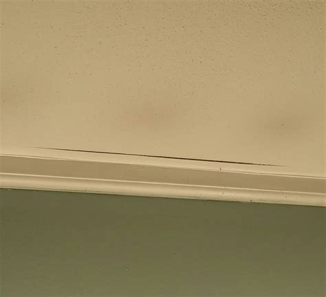 crown molding separating from ceiling