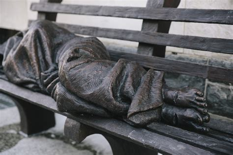 homeless jesus on park bench cardinal wuerl blesses new statue of homeless jesus