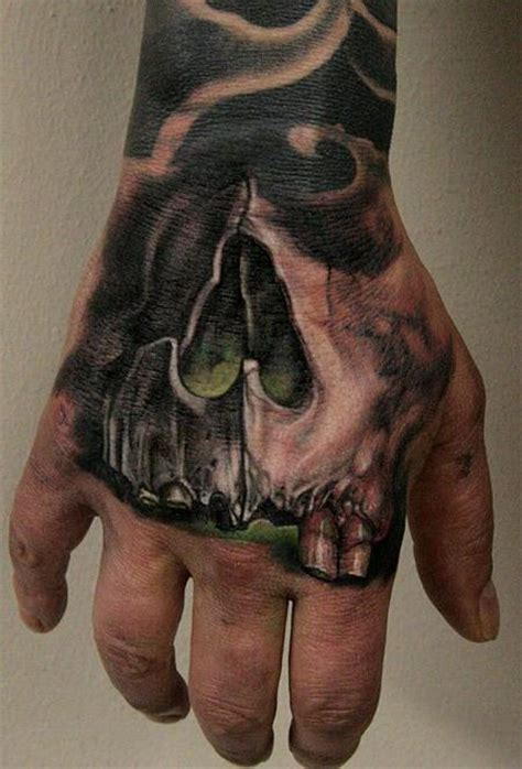 black and grey hand tattoo skull hand by thomas kynst tattoos