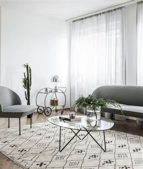 oslo sofa and chair by muuto and pedrera coffee table by