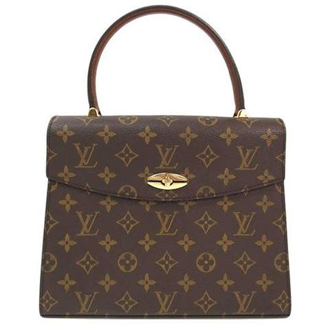 Purse Trend Black With A Touch Of Gold by Louis Vuitton Vintage Style Gold Evening Top Handle