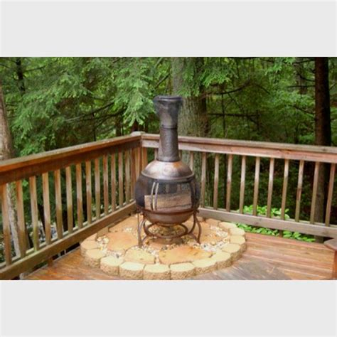 great idea to put your chiminea so it doesn t burn - Chiminea On Deck