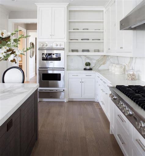 Amazing two tone kitchen design with walnut kitchen island