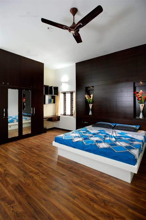 commodious master bedroom  wood flooring  king size
