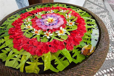 decorated water bowl with fresh flowers in ubud bali