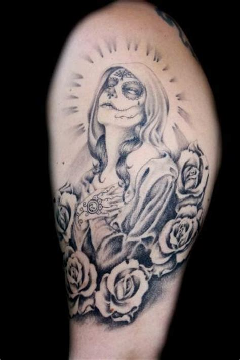 santa muerte tattoos various elements which can occur in