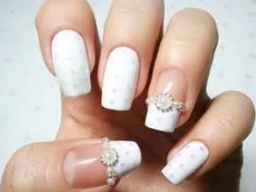 Cool and stylish white french manicure style bridal nail art idea