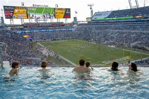 fields jaguar swimming in a football stadium kenyatalk