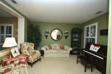 stylish transitional family room robeson design san stylish transitional living room before and after robeson