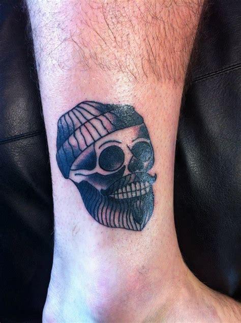minimalist tattoo brighton traditional skull tattoo with a twist done by alex newey