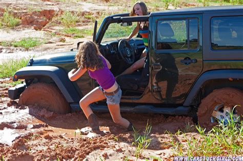 muddy jeep girls two girls stuck in mud with their jeep and their boots