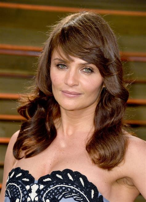 long hair with bangs over 40 helena christensen layered long brown wavy hairstyle with