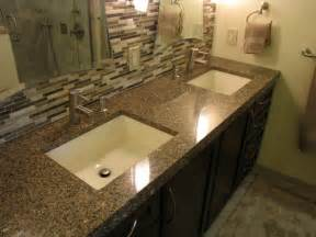 bathroom countertops experts in granite quartz white countertop and dark cabinetry make this bathroom