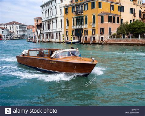 venice taxi boat water taxi on the grand canal venice italy stock photo