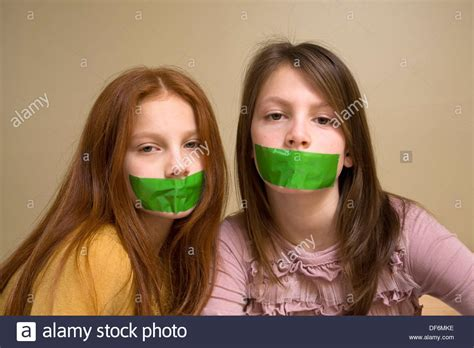 young pre teen models preteen girls with green tape on their mouths stock photo