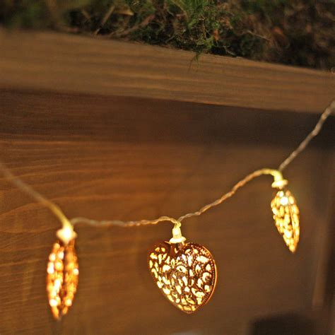 ornate copper string of lights by the wedding of