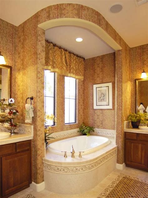 elegant bath a master bath bay with an arched soffit encloses the tub