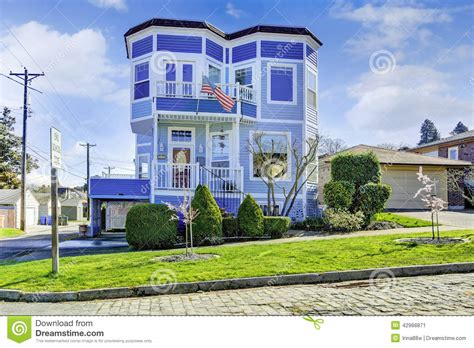 house of blue lights big bright blue house with american flag stock image