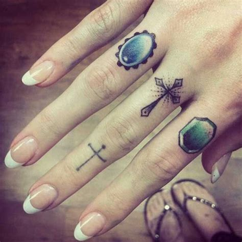 x tattoo on middle finger cross jewels finger tattoo tattoo pinterest love