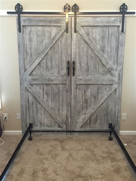 barn door headboard cheaper and better diy barn door headboard and faux barn door track hardware for the home