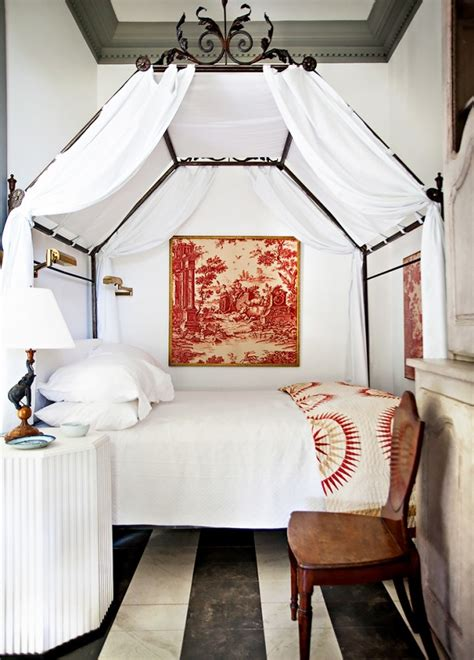 small bedroom with a canopy bed culture scribe