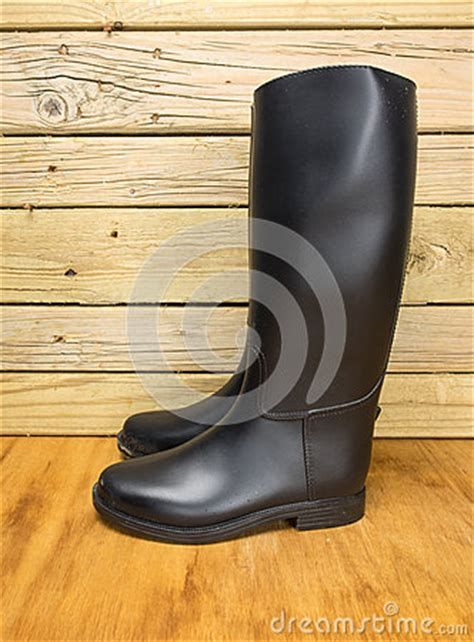 dirty riding boots riding boots in a stable stock photo image 48359056