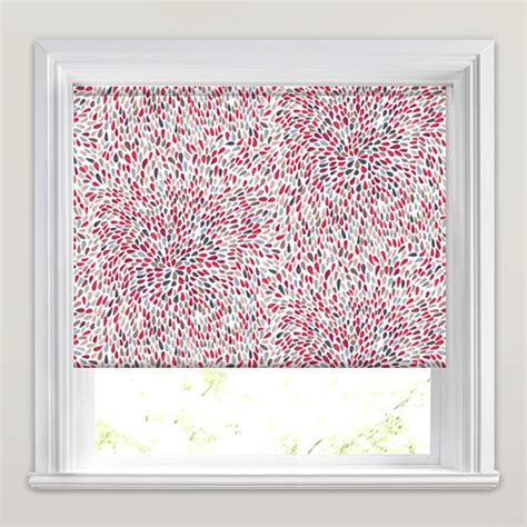 red patterned roller blinds red grey taupe white vibrant spiralling patterned