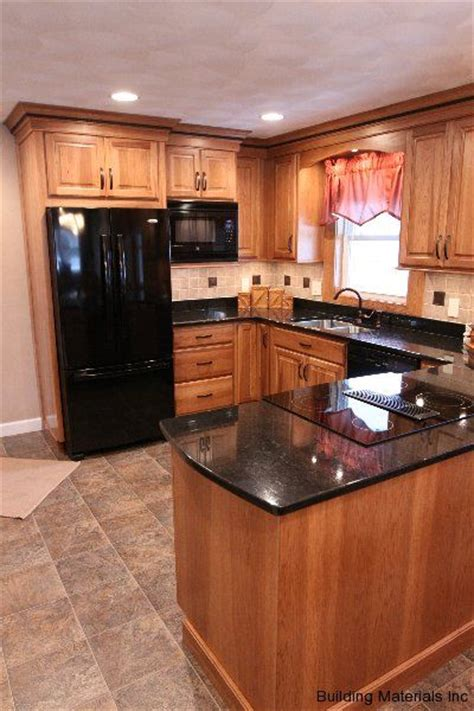 hickory floors with white cabinets black counter tile with accents back splash stone floor